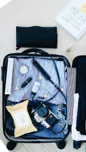 packing clothing neatly in suitcase for a long distance move