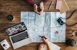 photo of people planning a trip with a map