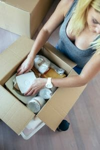 Woman packing glassware into a box
