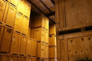 Wooden crates stacked high inside a warehouse