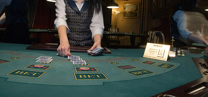 Las Vegas Casino Worker Dealing Cards on table
