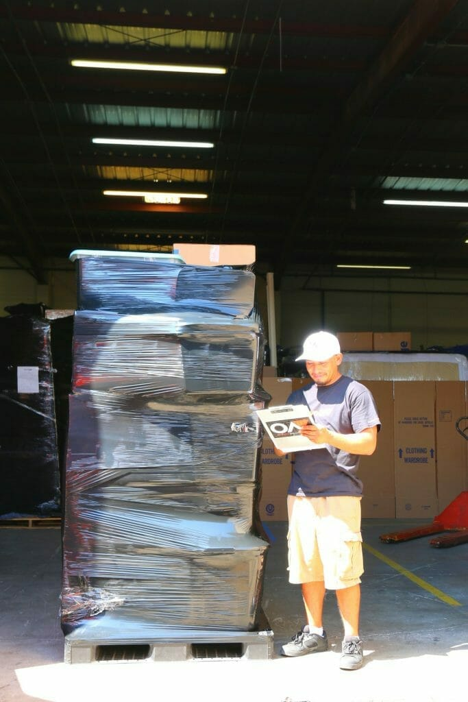 mover checking inventory of shipment