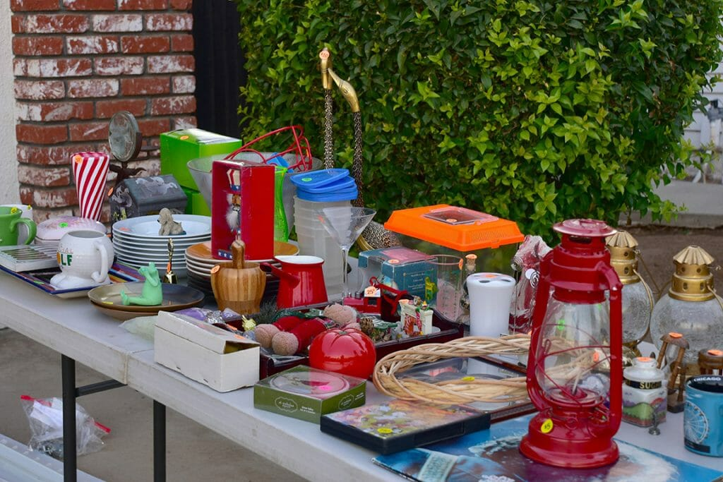 Table full of items at a moving sale