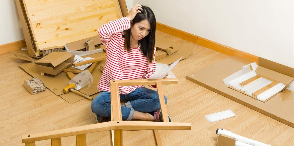 Woman confused on how to assemble her furniture